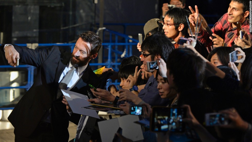 "Actor Hugh Jackman takes pictures with fans during the Tokyo premiere of ""X-Men: Days of Future Past"" on Tuesday, May 27."