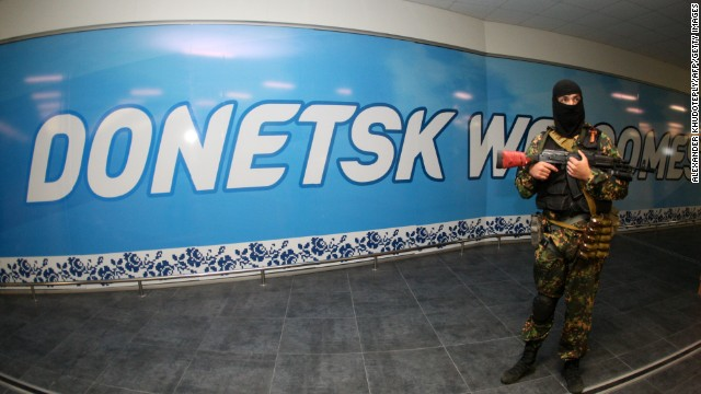 An armed pro-Russian militant takes position in the international airport of the eastern Ukrainian city of Donetsk on May 26, 2014.