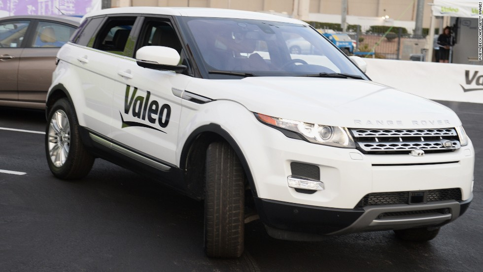 "A Range Rover Evoque equipped with Valeo self-parking technology backs into a parking spot during a <a href=""http://edition.cnn.com/2014/01/09/tech/innovation/self-driving-cars-ces/"">driverless car demo at the International Consumer Electronics Show</a> (CES) in January."
