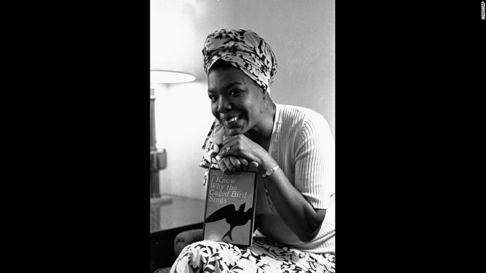 "Angelou poses with her book ""I Know Why the Caged Bird Sings"" in 1971. It was the first in a series of autobiographical books."