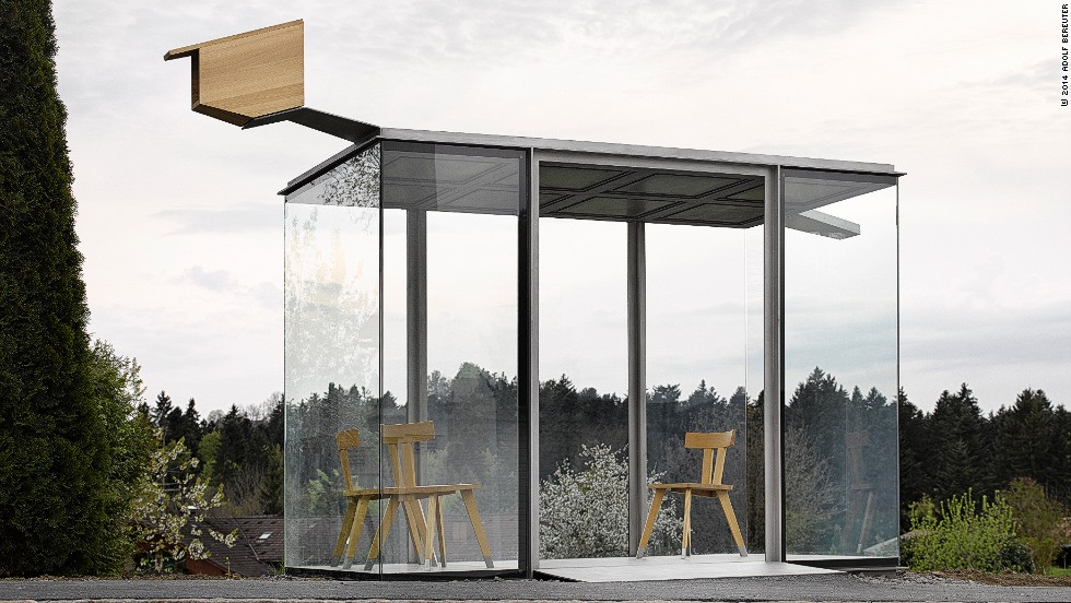 """Chilean architect <a href=""""http://www.serpentinegalleries.org/exhibitions-events/serpentine-galleries-pavilion-2014-smiljan-radic"""" target=""""_blank"""">Smiljan Radic</a>, who will also design this year's <a href=""""http://www.serpentinegalleries.org/exhibitions-events/park-nights-2014-smiljan-radic-conversation-julia-peyton-jones-and-hans-ulrich"""" target=""""_blank"""">Serpentine Summer Galler</a>y Pavilion in London, created a glass parlor with rural wooden chairs and a playful birdhouse."""