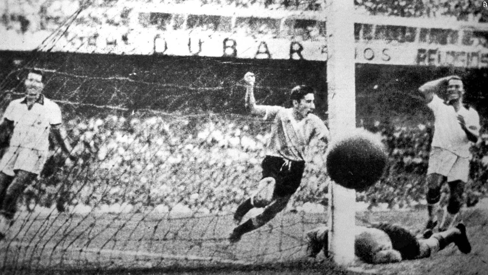 Uruguay's Alcides Ghiggia, center, scores the decisive goal in a 2-1 victory over Brazil at Rio de Janeiro's Maracana Stadium on July 16, 1950. With the result, Uruguay clinched its second World Cup title and spoiled the hopes of the host country. As Brazil prepares to host the World Cup for a second time this summer, here's a look back at what happened the first time around.