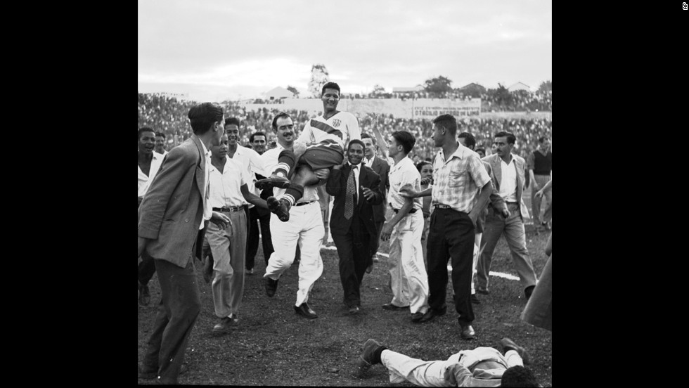 American forward Joe Gaetjens is carried off the field by fans after the United States upset England 1-0 in a first-round match in Belo Horizonte, Brazil. Gaetjens scored the winning goal, which is still considered one of the most important goals in American soccer history.