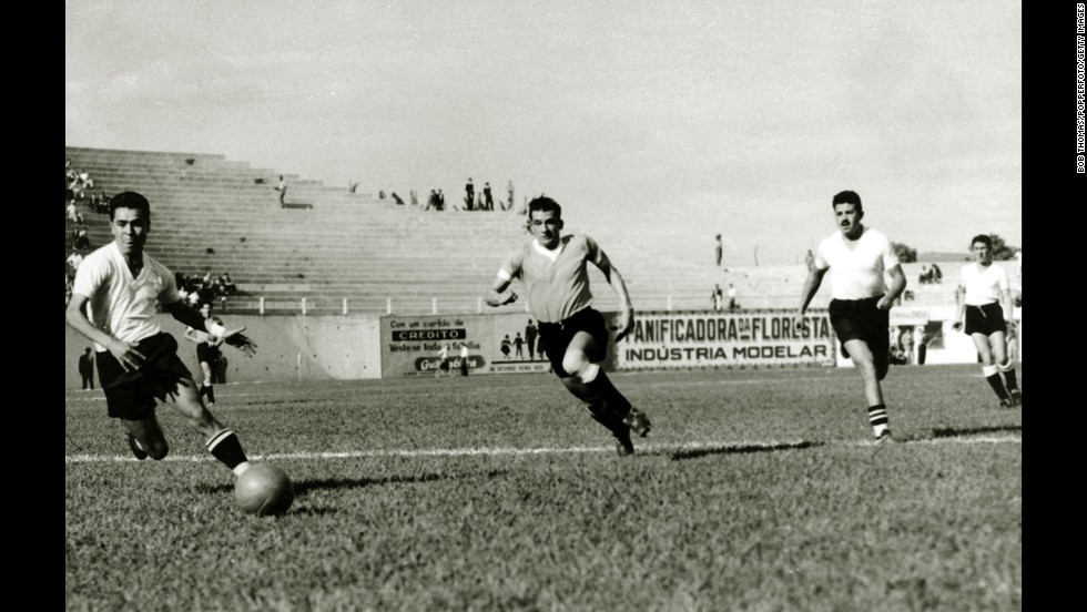 Uruguayan forward Julio Perez, center, races through the Bolivian defense during Uruguay's 8-0 victory in the first round. There were 13 teams competing in the tournament, which was the fourth World Cup.