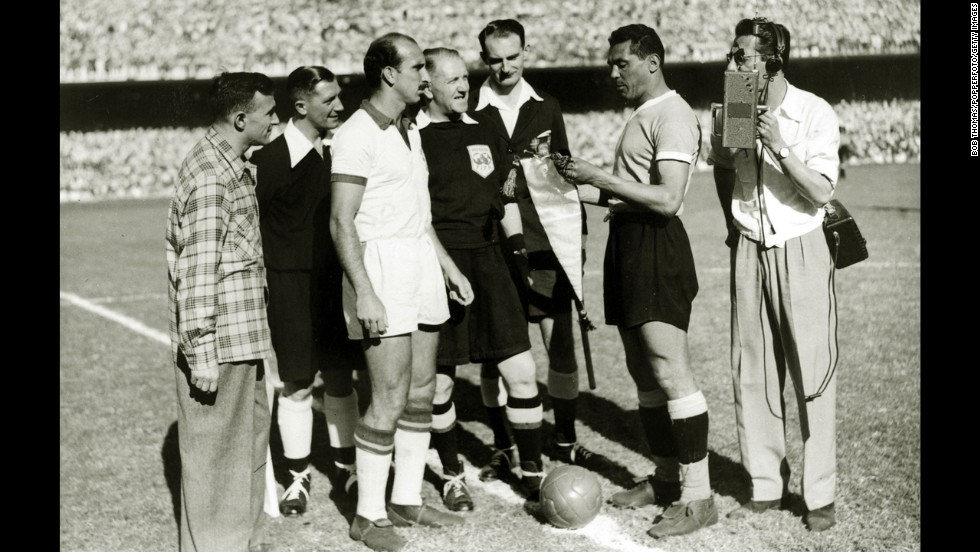 With a Brazilian radio reporter nearby, team captains August, left, of Brazil and Obdulio Varela of Uruguay exchange pennants before the decisive match of the tournament. Going into the match, Brazil only needed a draw to secure the title. Uruguay had to win.