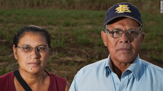 Juan Salgado, 65, poses with his lifelong partner Eugenia in the sugar cane fields of Chichigalpa, Nicaragua.