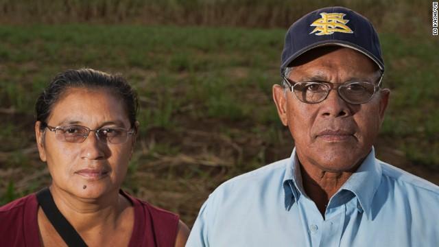Juan Salgado, 65, poses with his lifelong partner Eugenia in the sugar cane fields of Chichigalpa, Nicaragua.