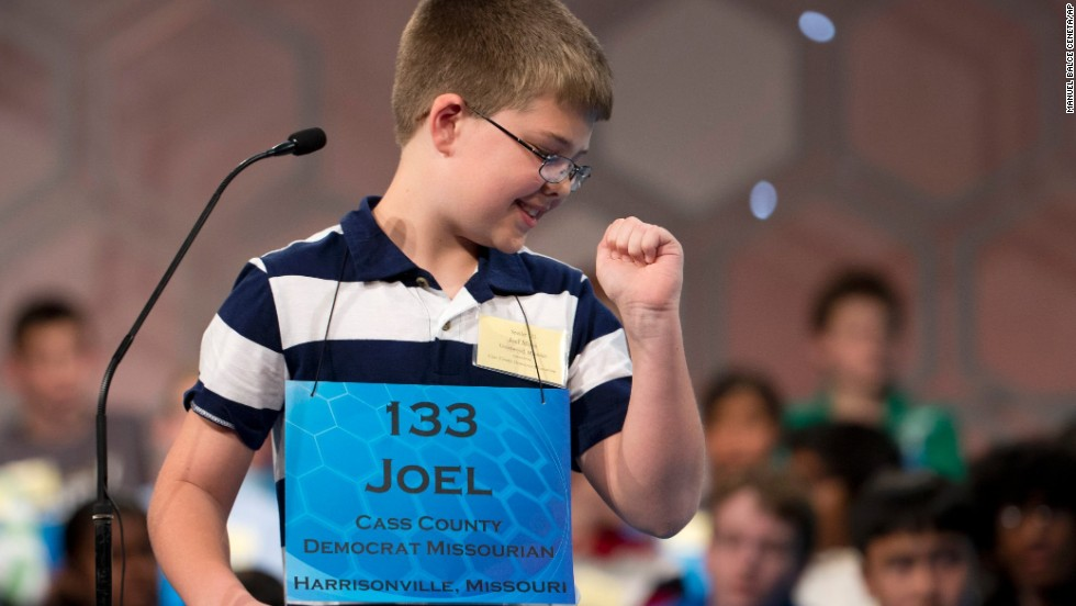 "Joel Miles, of Raymore, Mississippi, pumps his fist after correctly spelling the word ""sporran"" on May 28."