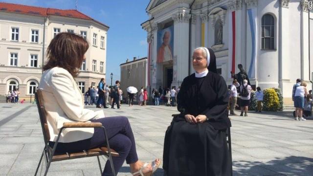 Paula Newton and Sister Benedykta Mazur sit outside Wadowice Basilica