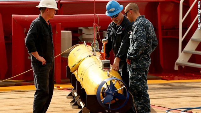 Technicians work on an autonomous underwater vehicle in 2014.