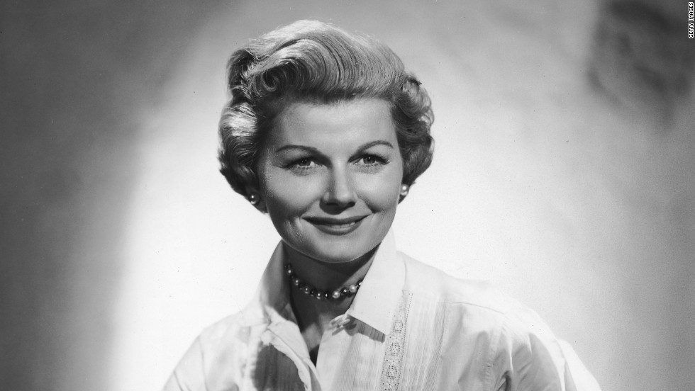 "Barbara Billingsley wears pearls and a white blouse with lace stitching, her usual attire as mother and housewife June Cleaver in the 1950s show ""Leave it to Beaver."" Female characters in '60s TV moved beyond big skirts and heels into more adventurous territory."