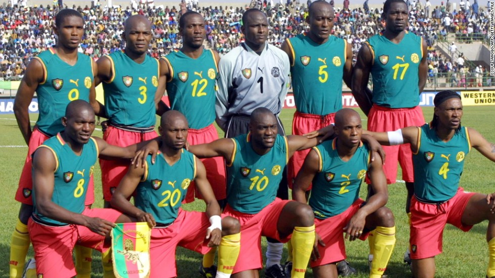 "Cameroon's ""Indomitable Lions"" headed off for the 2002 tournament in Japan and South Korea with no fear, and no sleeves. With the bulging biceps to make the minimal look a success, Cameroon were set to make a stir at Asia's first World Cup. But, before we could enjoy this NBA-esque jersey, football rulemakers FIFA stepped in and insisted Cameroon must add sleeves to its ""vests."" The result was a not-so-cool, more conventional, strip, leaving us to ponder what might have been."