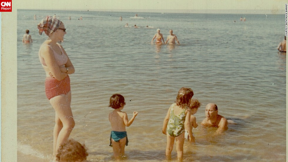 "This family photo from a 1965 trip to Long Island, New York, has special meaning for <a href=""http://ireport.cnn.com/docs/DOC-728247"">Beth Alice Barret</a> all these years later. She's not pictured, but her dad is seen here playing with her then-2-year-old brother. ""These special moments mean so much to my family because a few years later, our father died suddenly,"" she said. This photo kept that moment alive for her."