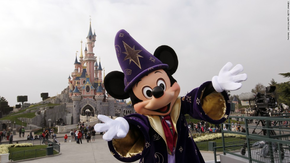 6. Mickey Mouse poses in front of the Sleeping Beauty Castle at the Disneyland park outside of Paris.