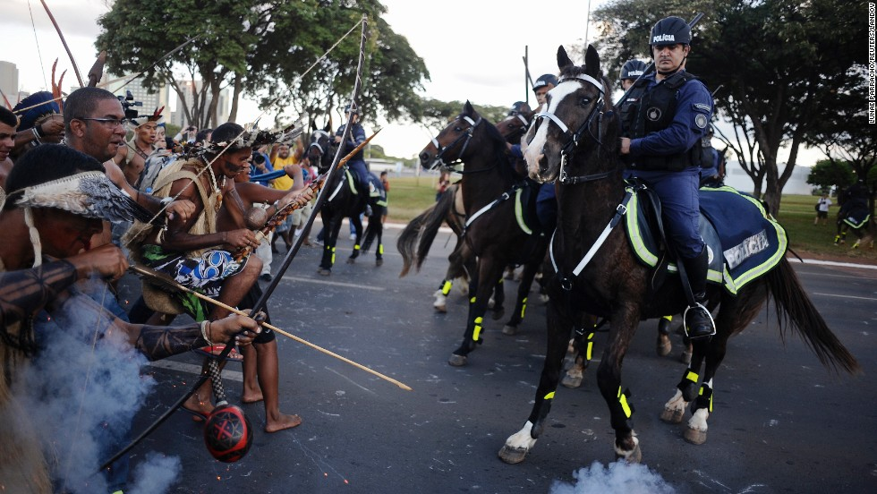 Police in Brasilia, Brazil, use tear gas to impede natives from marching toward the Mane Garrincha stadium and protesting the World Cup on Tuesday, May 27. The World Cup trophy was on public display at the stadium.