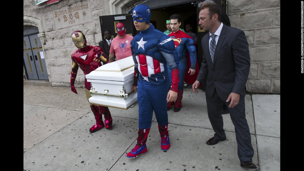 Pallbearers dressed as Sebastian Gerena's favorite superheroes carry his coffin during the 7-year-old's funeral in Philadelphia on Wednesday, May 28. The young boy, who had a rare heart defect, died after collapsing at his school.