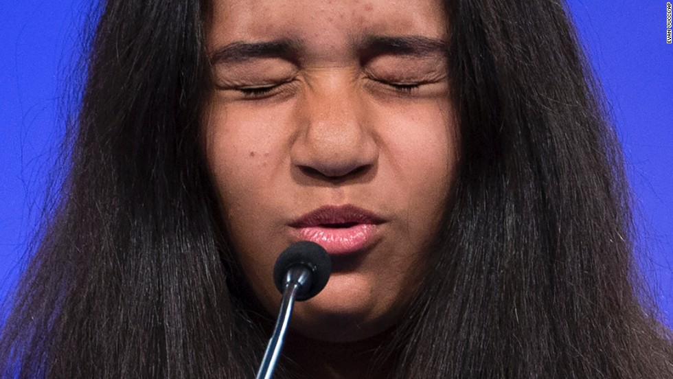 "Alexandra Harper, of Guayama, Puerto Rico, concentrates before spelling the word ""bildungsroman"" on Wednesday, May 28, during the <a href=""http://www.cnn.com/2014/05/28/living/gallery/national-spelling-bee-faces/index.html"">Scripps National Spelling Bee</a> in Oxon Hill, Maryland. More than 250 students from the United States and seven other countries gathered to compete in the annual contest."