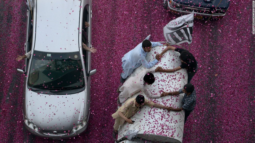 Flower petals cover the streets during a rally in Islamabad, Pakistan, on Wednesday, May 28 -- the anniversary of Pakistan's first nuclear tests in 1998.