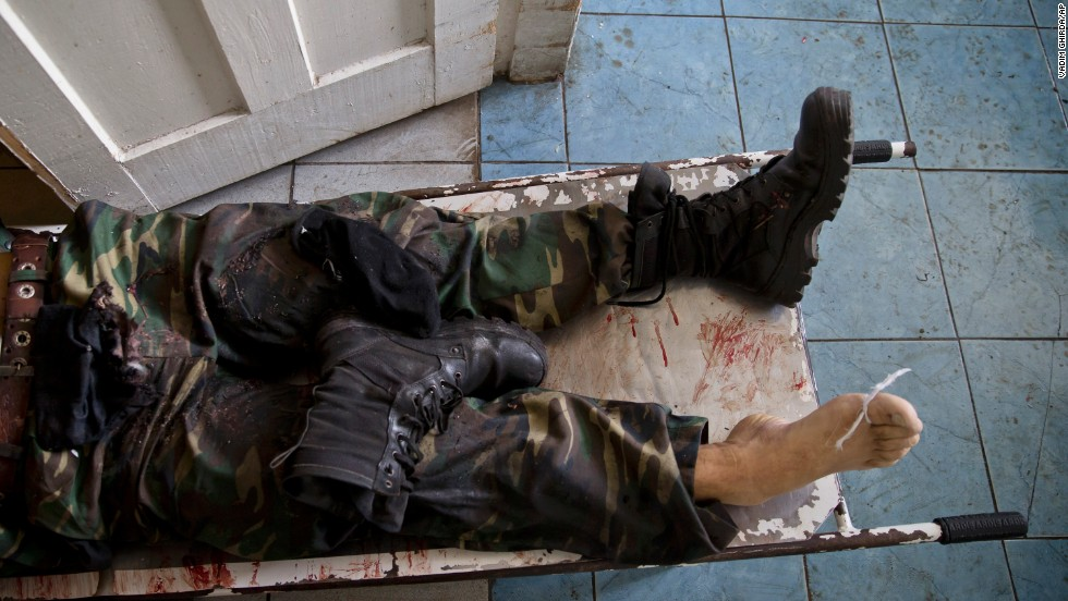 The body of a pro-Russian militant lies on a stretcher at a morgue in Donetsk, Ukraine, on Tuesday, May 27. He was killed in clashes around Donetsk's airport, which was seized by pro-Russian separatists a day earlier. Ukrainian forces moved in and reclaimed the facility.