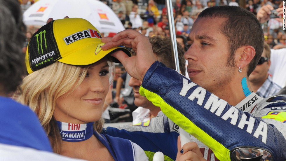 Rossi jokes with a grid girl before the U.S. MotoGP in Indianapolis in 2009.