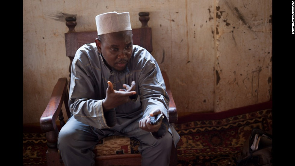 Imam Aboubakar Souleymane speaks next to a group of Muslim youth in Bambari. Many of the town's Muslims fear the peacekeepers will disarm the Republican Forces and leave their community defenseless against the mostly Christian anti-balaka militia.