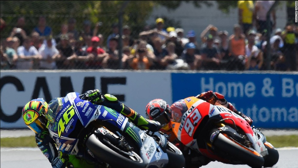 "Introducing ""The Doctor"" of MotoGP -- Valentino Rossi briefly leads Marc Marquez at the French MotoGP on 18 May 2014."