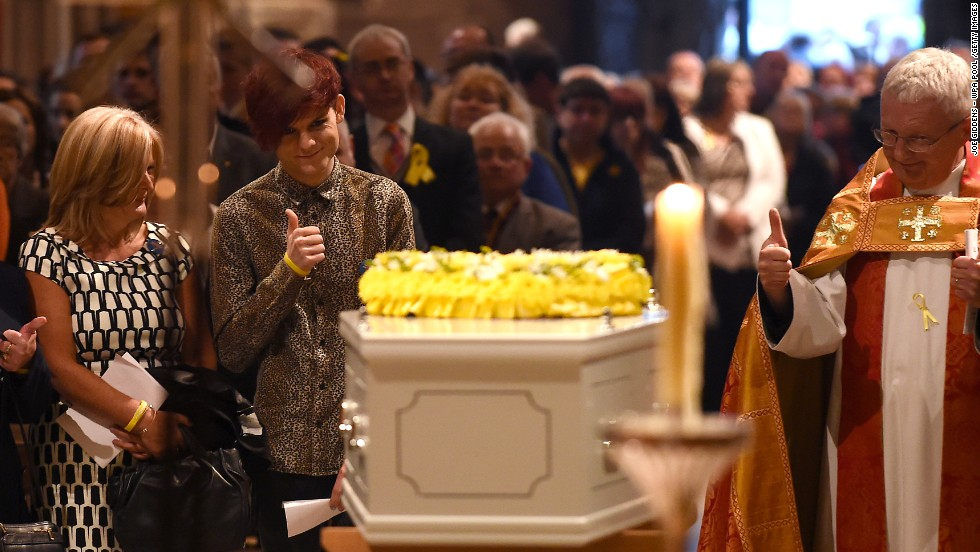 MAY 30 - LICHFIELD, ENGLAND: Stephen Sutton's brother Chris gives a thumbs up at his coffin. The teenager won over the hearts of millions with his determination, generosity and good humor in the face of his terminal illness. Stephen raised over $5.4 million for a teenage cancer charity before losing his battle with the illness at the age of 19 two weeks ago.