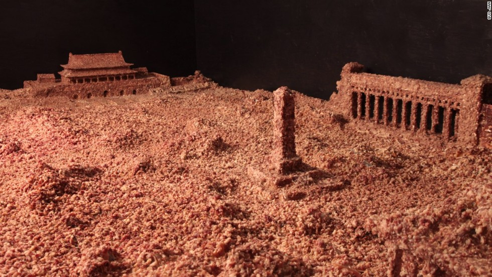 "Artist Guo Jian's 2014 installation, ""The Square"", consists of a model of Beijing's Tiananmen Square covered in 160 kilograms of ground pork."