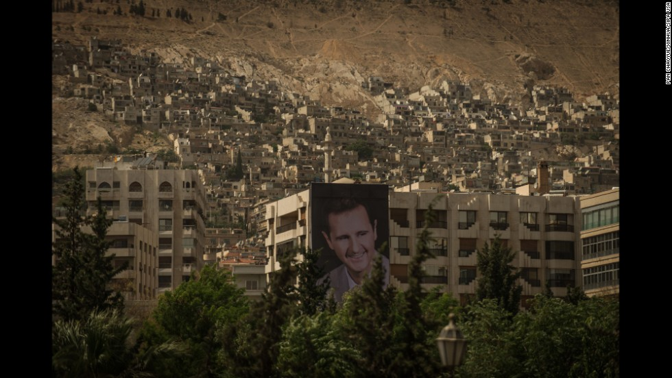 A giant poster of Syrian President Bashar al-Assad is seen in Damascus, Syria, on Saturday, May 31, as the capital prepares for presidential elections.