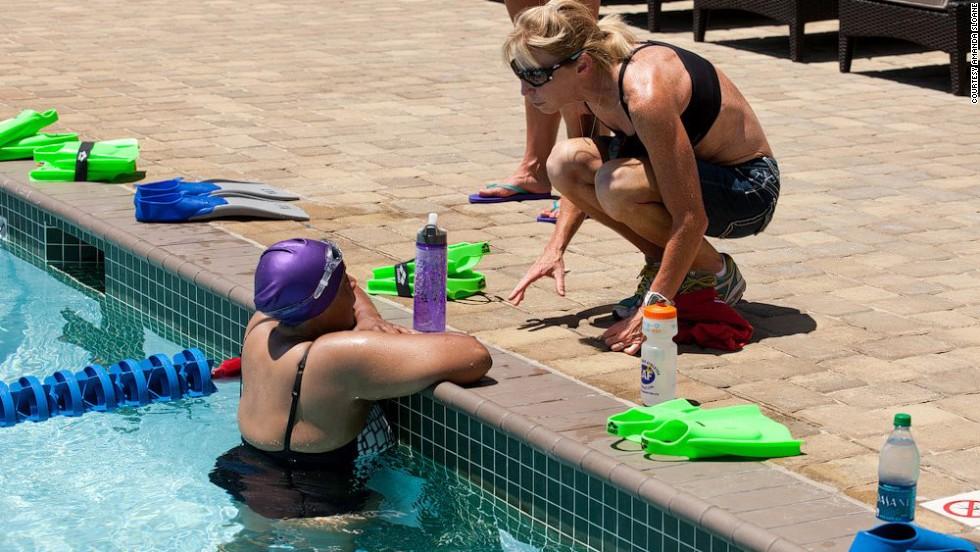 Karen Manns gets a few swimming tips from Paula Newby-Fraser, an Ironman World Champion.