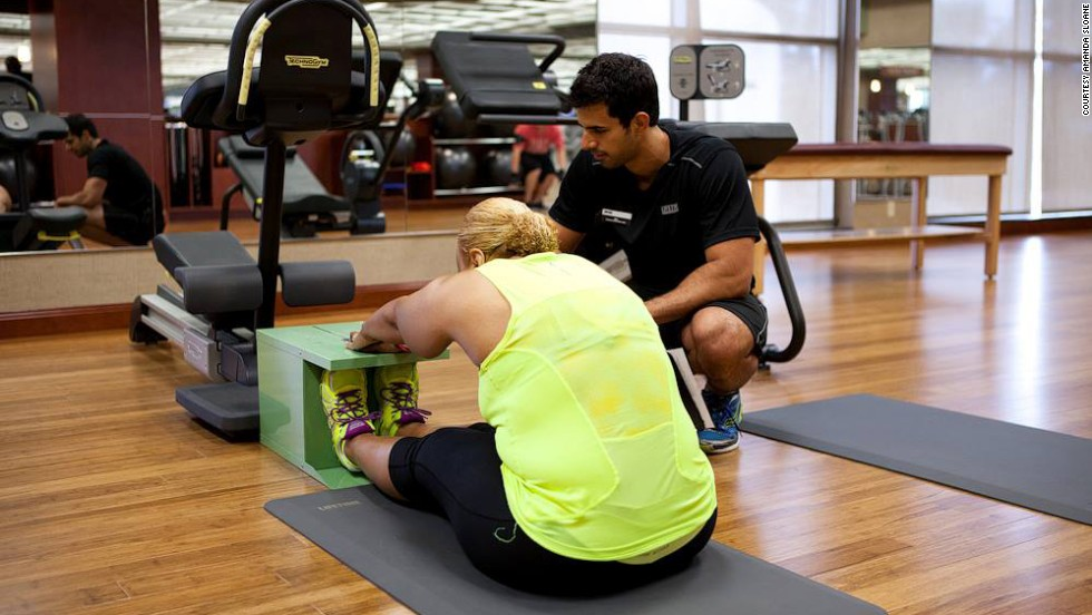 "Manns reaches forward during a stretch test at the gym. She's had two hip replacements, but says she's ""<a href=""http://www.cnn.com/2014/03/14/health/fit-nation-karen-hips/"">too young not to run.</a>"""