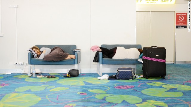 Passengers sleep in Darwin International Airport on May 31, 2014.