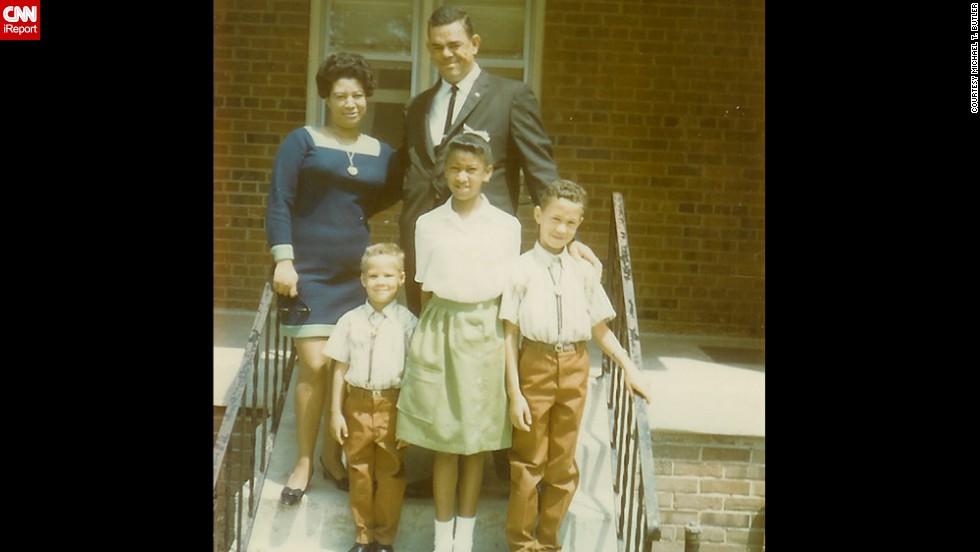 "<a href=""http://ireport.cnn.com/docs/DOC-1119904"">Michael T. Butler</a>, the little guy in the front row, and his well-dressed family members are seen here  in front of their home in Upper Marlboro, Maryland, in June 1969. ""Life was slower, many of us hated the pace, but when we grew up, we returned to what we had lost,"" he said. ""I moved back to the hometown of my youth because I was looking for what I had lost. Peace and quiet."""