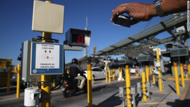 A traveler crossing into the U.S. from Mexico shows his ID to an automatic reader at San Ysidro, California.