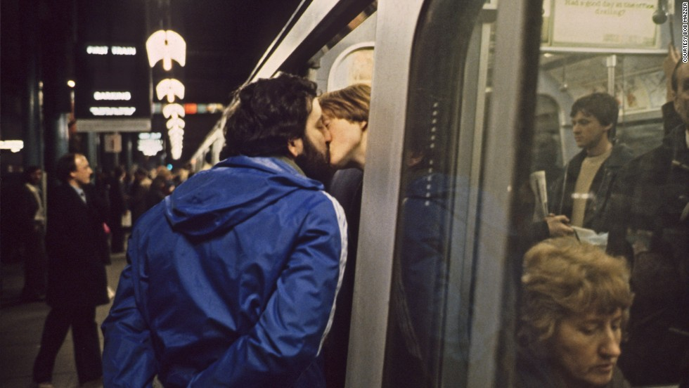 "Many of Mazzer's images capture intimate moments, such as this kiss before the doors close on a tube in Baker Street. ""What drew me to it was the contrast between him and her,"" Mazzer says. ""He seemed completely disinterested,"" while she was ""really kissing him."""