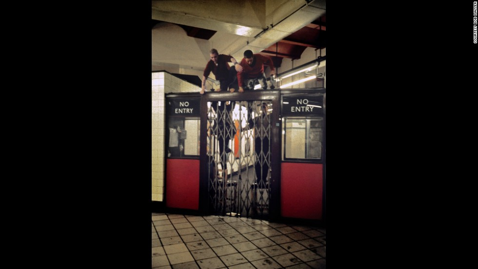 "Mazzer's images have captured many late night scenes, as he traveled to and from his work at a cinema. In this one, boys clamber up and jump over a closed gate. Mazzer notes how they'd taken the little stools used by ticket collectors to assist their escape. ""There's nothing like that you can climb over anymore, it's all ticketed barriers,"" he says."