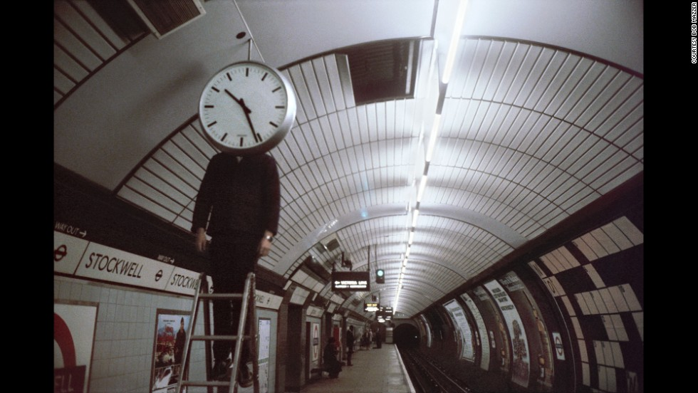 "This image, from Stockwell station, has become known as ""Clockwell."" It was snapped the exact moment the man dropped his hands, Mazzer says. ""It looks like he was just standing there but he was actually busy... all the time, and he [dropped his hands] for a moment."" It was ""just a one off -- there was no lead up, or lead off. It was just one shot."""