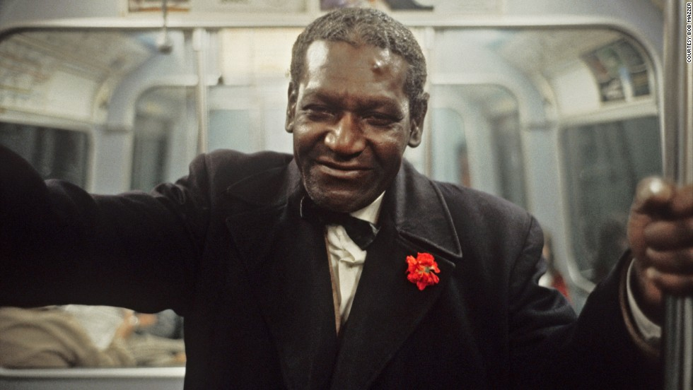 """While many of Mazzer's subjects are caught unawares, this man with a bright red flower gazes straight down the barrel of the camera. """"He was so amendable to being photographed,"""" Mazzer says. """"He was just cool, he looked so much like he'd just come from a jazz club."""""""