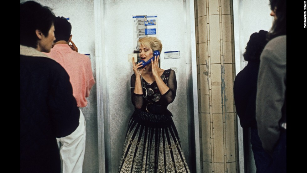 "London-born Bob Mazzer has been photographing in the city's underground transport network for four decades. This shot, from the 1980s, is one of his favorites. The woman, making a call from a public phone, was so theatrical he assumed she was an actress being filmed.  ""She was done up like a starlet,"" he says."