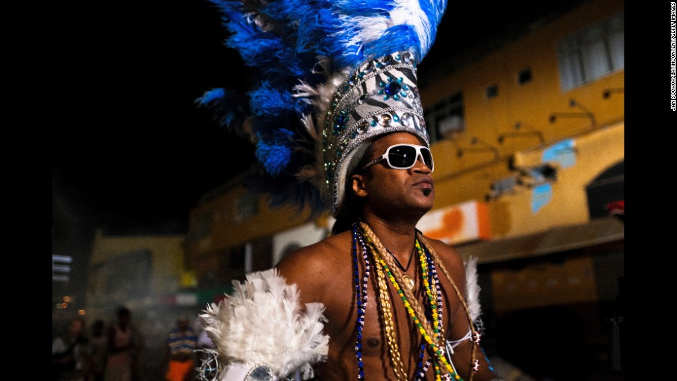 Well-known Bahia musician Carlinhos Brown dances before Salvador's festival of Yemanjá, the goddess of the sea. Yemanjá is one of the most popular orixás, the deities from the Afro-Brazilian religion of Candomblé.