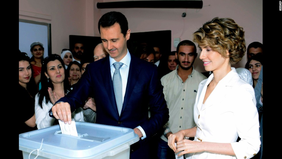 In this photo released by Syria's national news agency SANA, al-Assad casts his vote in Damascus on June 3. At right is his wife, first lady Asma al-Assad.