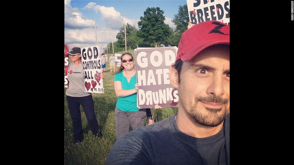 "Protesters from Westboro Baptist Church are seen behind country music star Brad Paisley in this selfie <a href=""http://instagram.com/p/ouJUqsN5QO/"" target=""_blank"">he posted</a> before his concert Sunday, June 1, in Bonner Springs, Kansas. The Kansas church is known for its virulently anti-gay protests. ""Westboro Baptist Selfie!!"" Paisley wrote. ""Or west-Burro(ass) selfie. Hopefully they can hear the show out here. We'll play loud."""