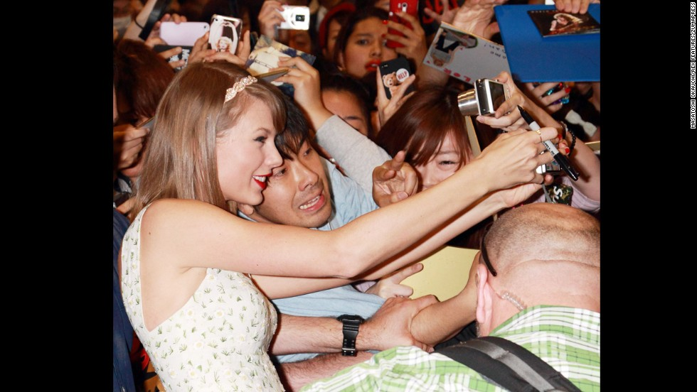 Singer Taylor Swift takes a selfie with a fan Saturday, May 31, at Narita International Airport in Narita, Japan. She had a concert the next day in Tokyo as part of her Red Tour.