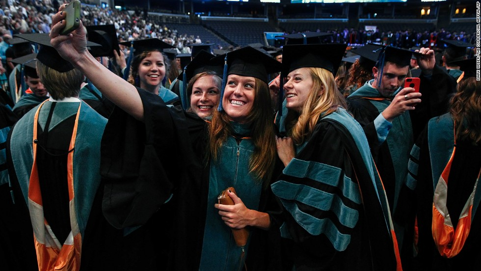 From left, friends Jennifer Morton, Jaclyn Strand and Mary VanDeven take a photo Friday, May 30, as they wait to receive their doctorate degrees at the University of Tennessee Health Science Center in Memphis, Tennessee.