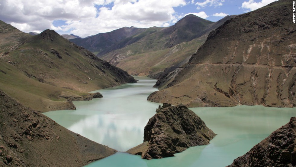 The shimmering turquoise waters of Yamdrok Yumtso lake is one of the sights that greet riders as they climb to lung-bursting heights in the shadow of Everest. The road stretches between Lhasa and the Nepalese border.