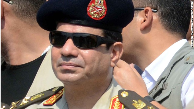 Egyptian Defense Minister and Military Chief General Abdel Fattah al-Sisi attends the funeral of Giza security chief Nabil Farrag in the district of Giza, on the outskirts of Cairo, on September 20, 2013