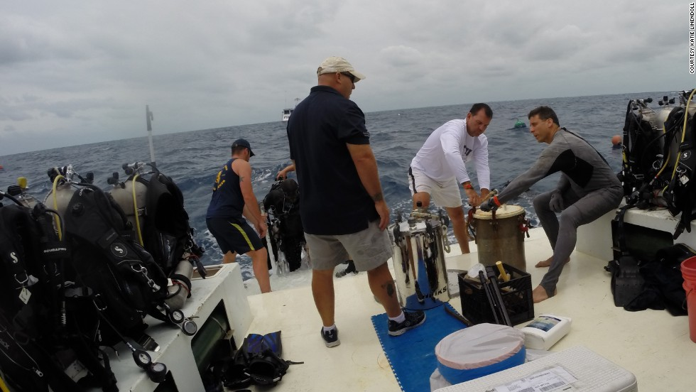 On the surface, FIU teams prepare pots with dry clothes, camera equipment and other gear to be sent down to Aquarius.