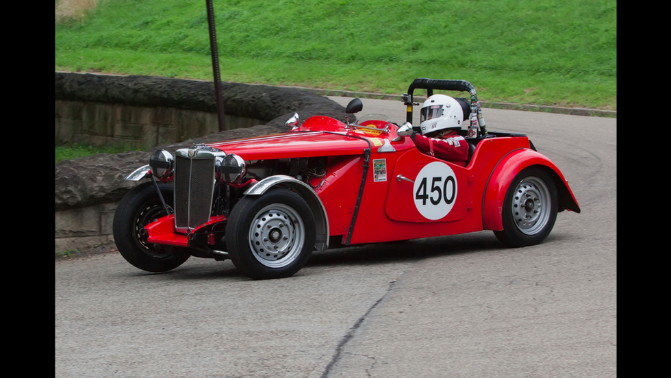 This stunning red 1953 MG TD was rescued from a barn in Ohio 6 years ago, says owner Michael Barstow, who plans to show it off at the Indy event.