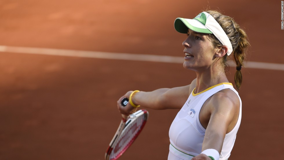 Germany's Petkovic challenges a decision as she slips to a straight sets defeat to Halep in Paris.