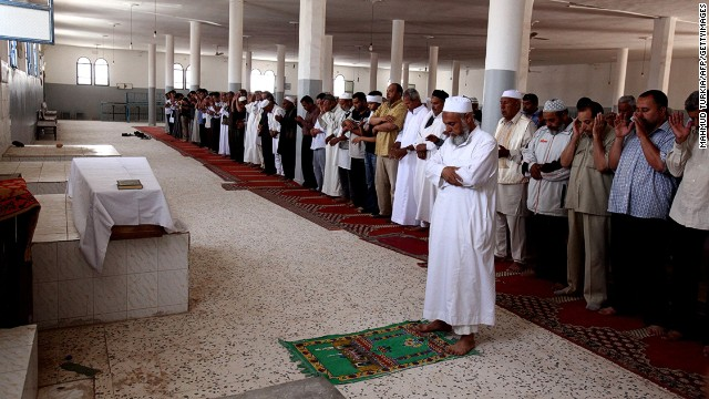 Friends and relatives pray over body of Abdelbaset Ali Mohmed al Megrahi during his funeral on May 21, 2012 in Janzur, Libya.